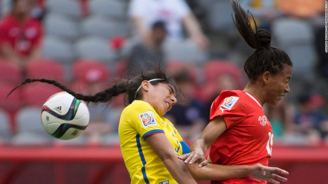 Switzerland's Eseosa Aigbogun, right, and Ecuador's Nancy Aguilar go for a header.