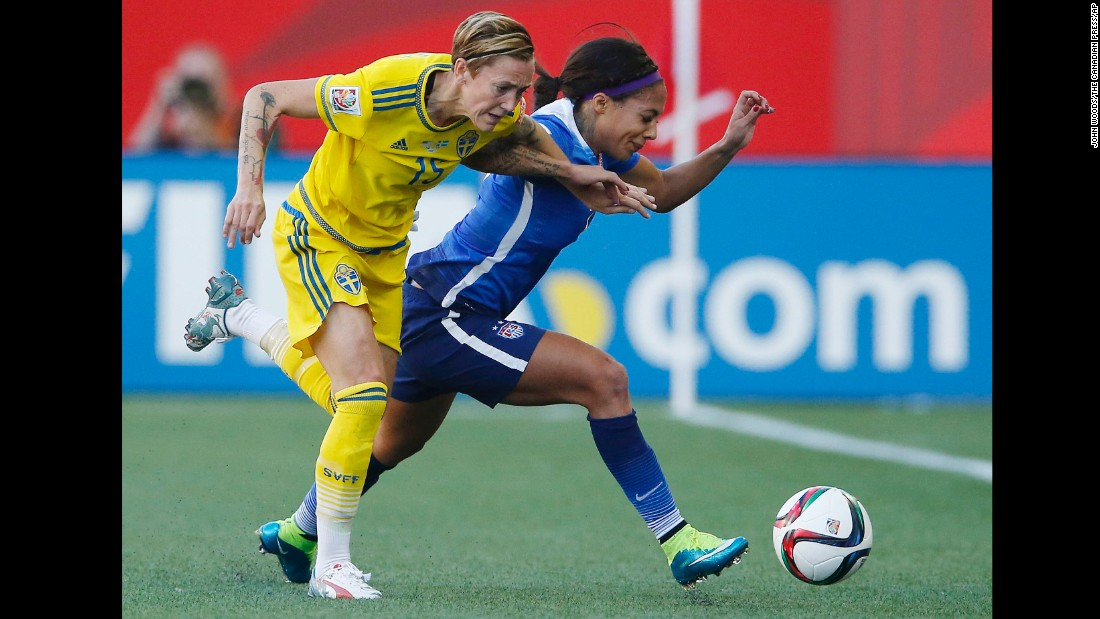 Therese Sjogran of Sweden, left, and Sydney Leroux of the United States chase down a ball during their scoreless draw June 12 in Winnipeg.