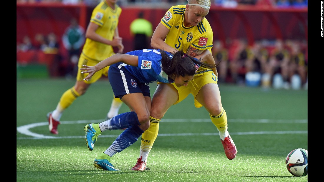 U.S. forward Christen Press, left, fights for the ball with Sweden defender Nilla Fischer.