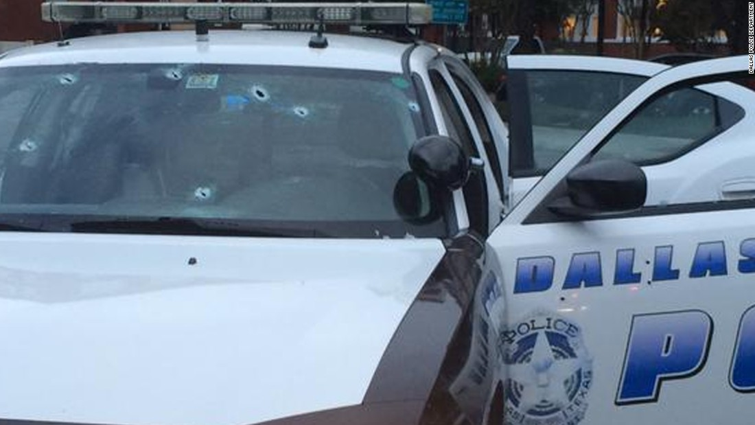Dallas police released a photo of a squad car struck by bullets. No officers were injured.