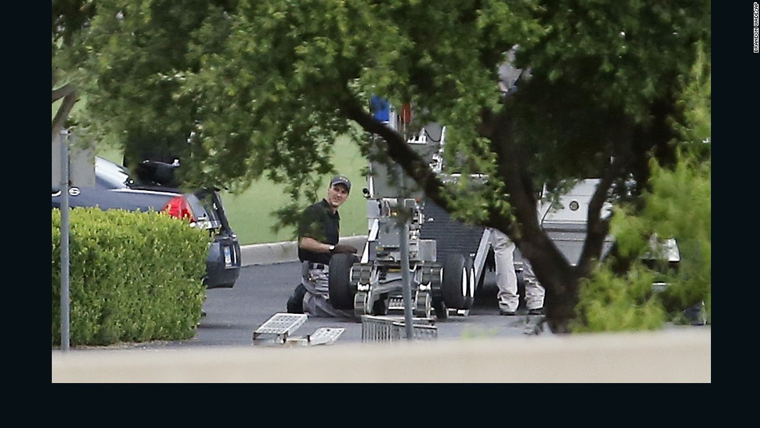 Police setup a remotely operated robot during the standoff.