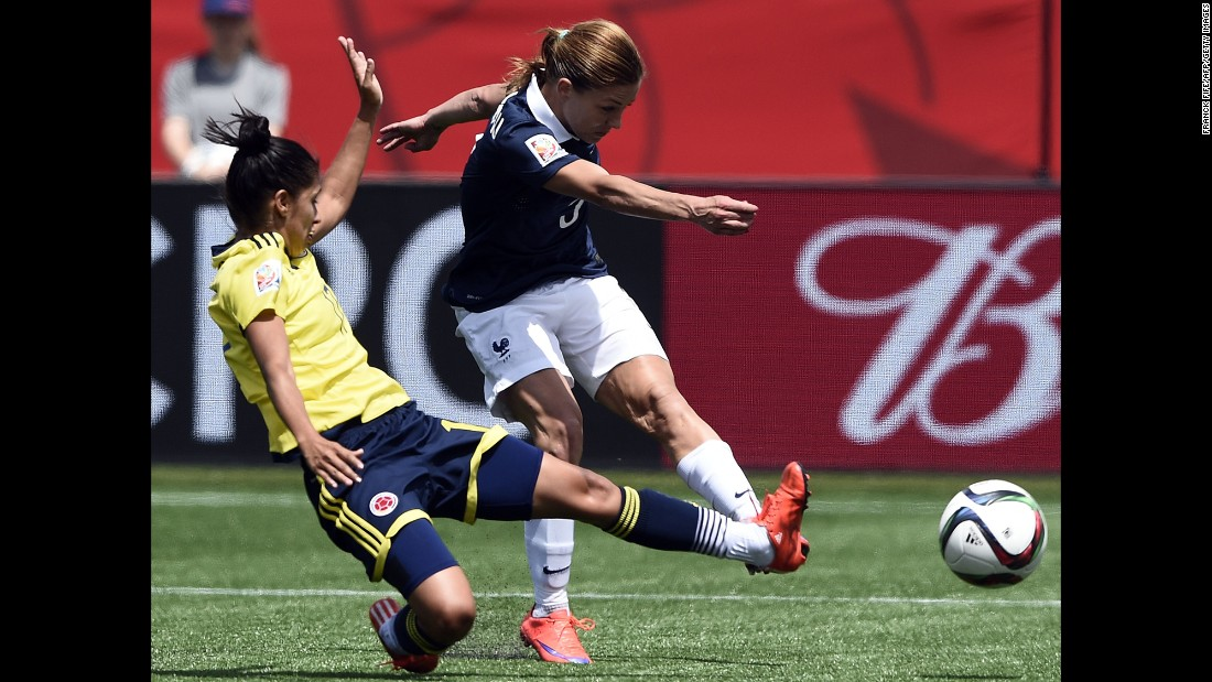 French defender Laure Boulleau, right, shoots next to Colombian midfielder Carolina Arias during a match in Moncton on June 13. Colombia won 2-0.