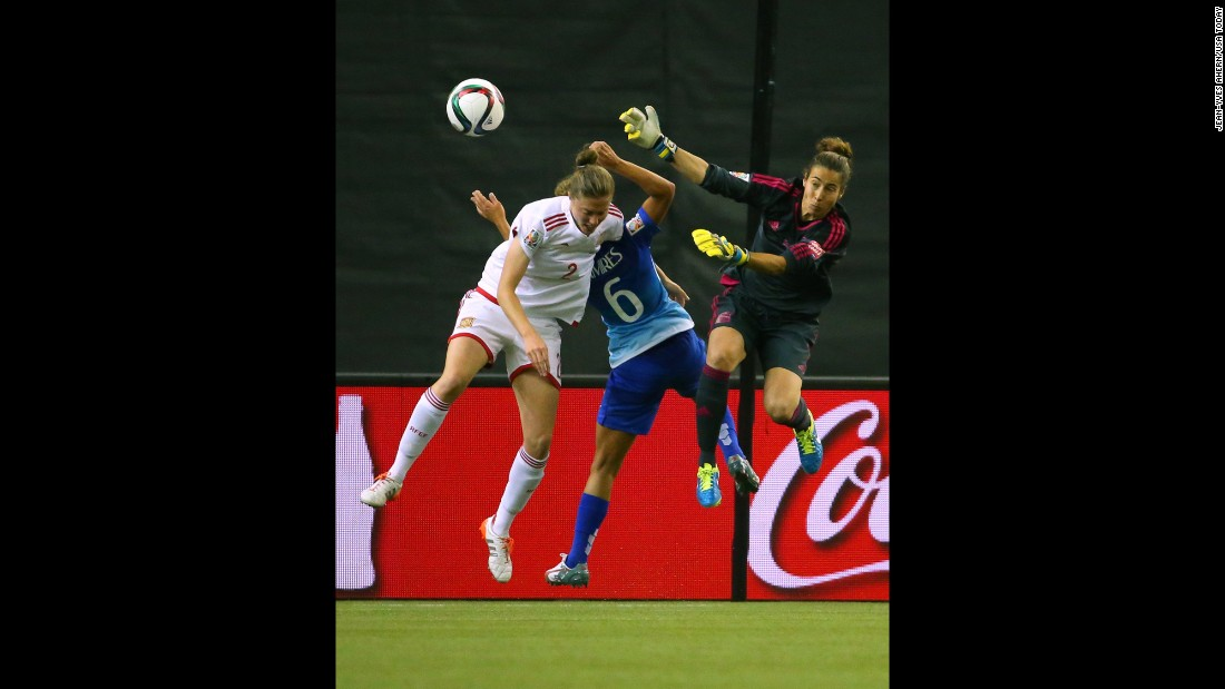 Spain's Celia Jimenez, left, leaps for the ball near Brazil's Tamires and Spanish goalkeeper Ainhoa Tirapu during a match in Montreal on June 13. Brazil defeated Spain 1-0.