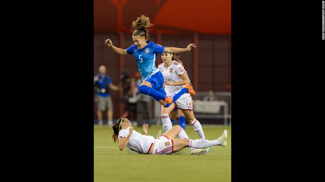 Brazil's Andressa jumps over Virginia Torrecilla of Spain.