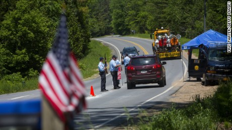 Department of Corrections officers work a roadblock in Saranac, New York on Saturday, June 13.