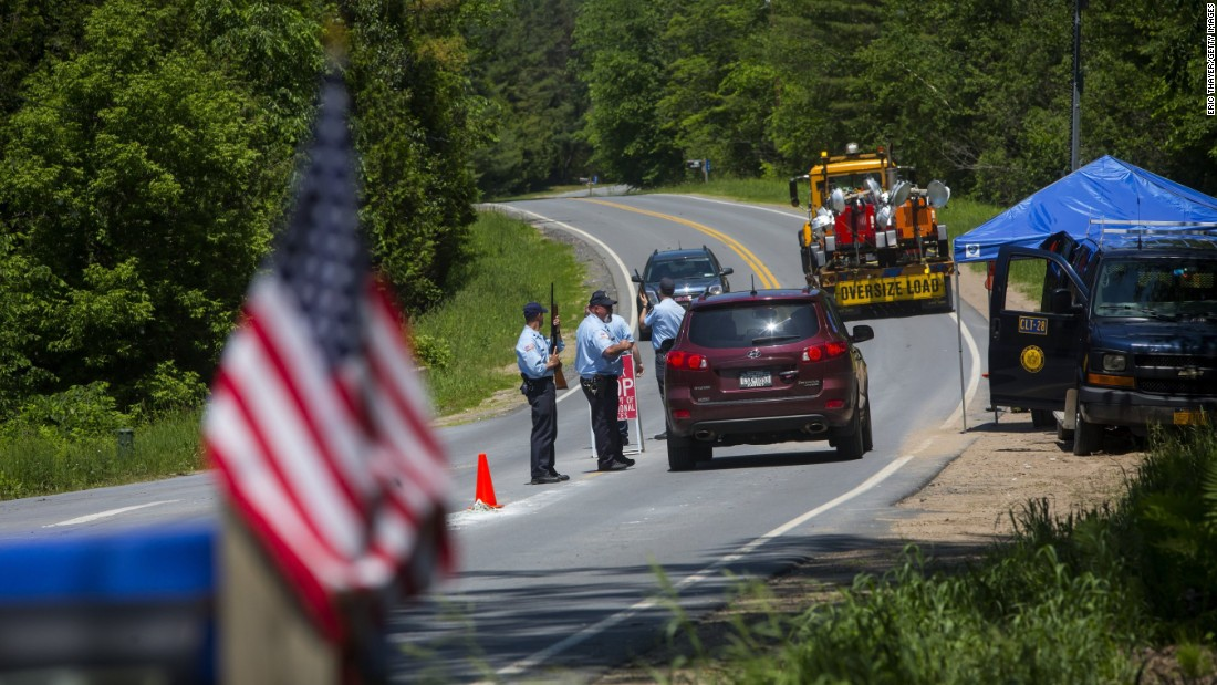 Department of Corrections officers work a roadblock in Saranac, New York, on Saturday, June 13.
