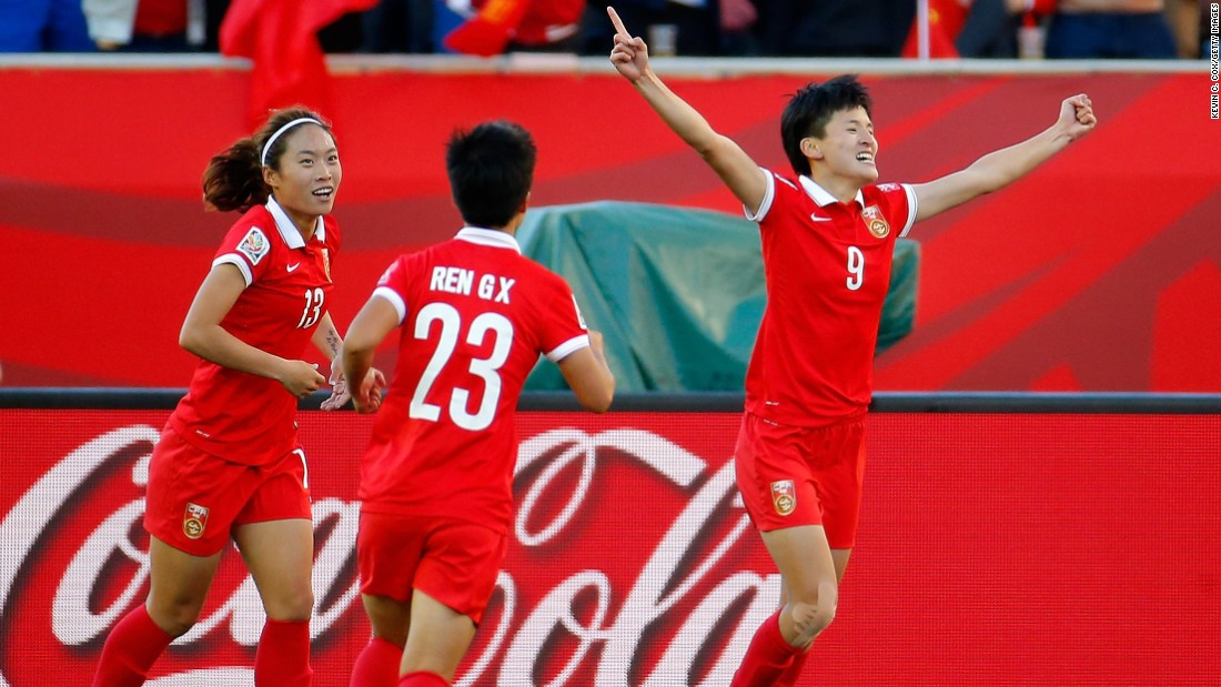 Wang, right, celebrates after scoring China's second goal.