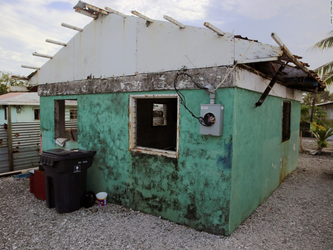 Angie Hepisus and her family said they decided not to repair this house after it was damaged in floods. Land in the Marshall Islands is managed communally by chiefs, so families often live in clusters together.