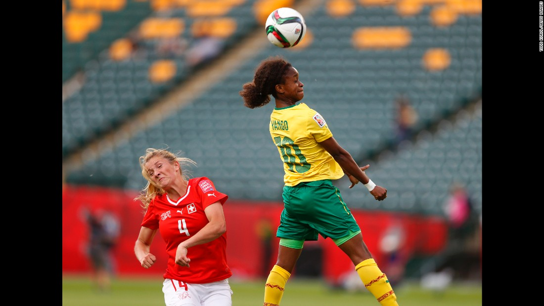 Rinast reacts as Jeannette Yango of Cameroon heads the ball.