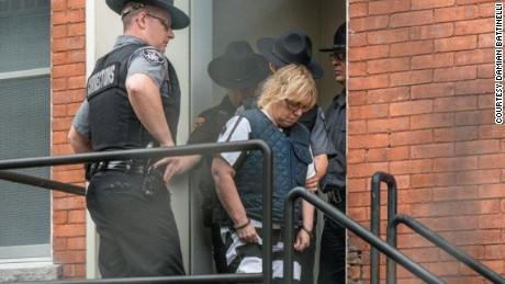Photos of Joyce Mitchell leaving courthouse