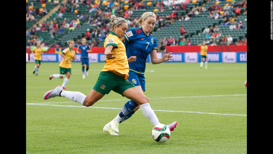 Australia's Kyah Simon, left, and Dahlkvist race for the ball.