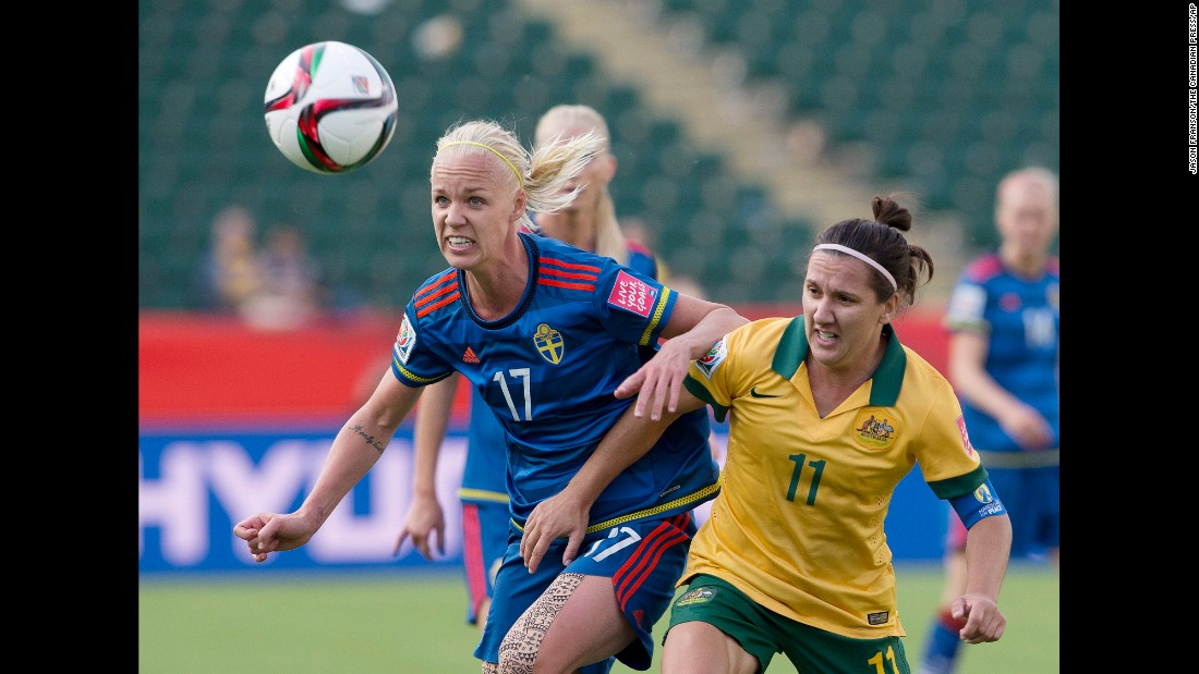 Australia's Lisa De Vanna, right, and Sweden's Caroline Seger watch the ball.