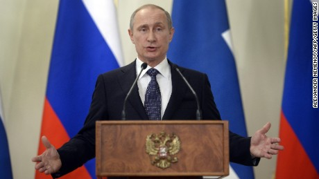 Russian President Vladimir Putin answers journalists' questions during a joint press conference with his Finnish counterpart Sauli Niinisto (not pictured) at the Novo-Ogaryovo residence, outside Moscow, on June 16, 2015.