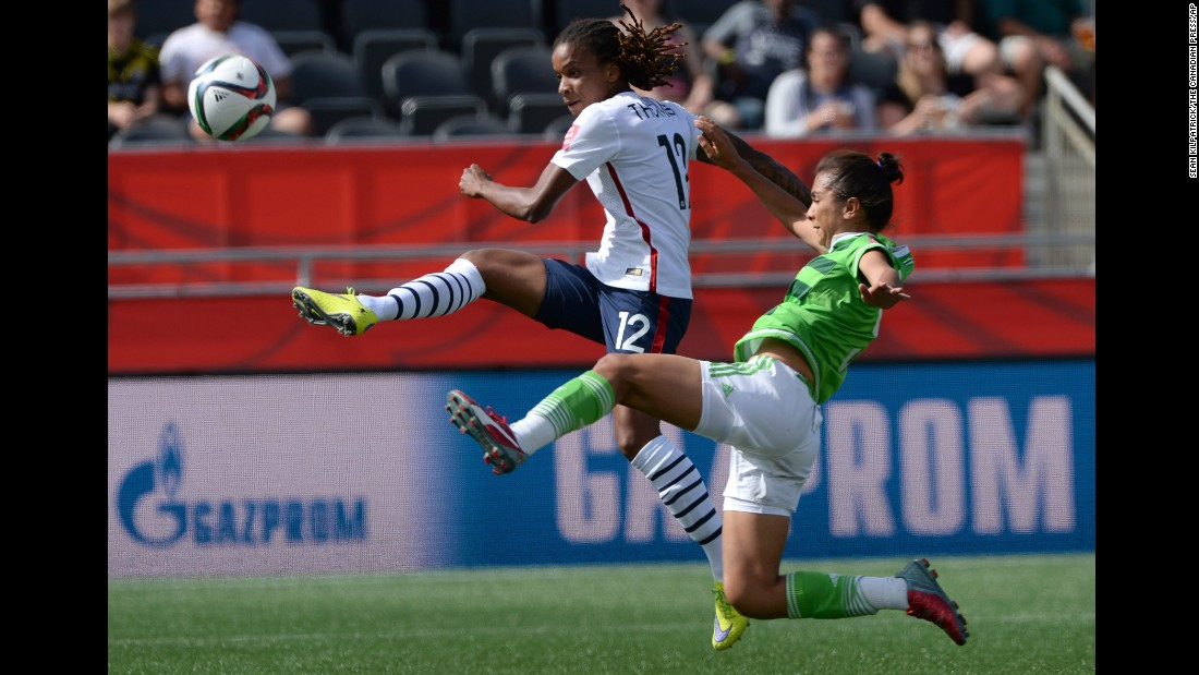 France's Elodie Thomis, left, drives the ball past a Mexico defender.