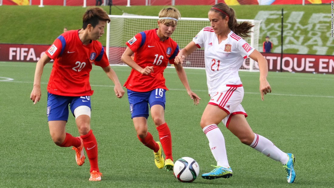 Hyeri Kim, left, and Yumi Kang of South Korea defend Alexia Putellas of Spain.