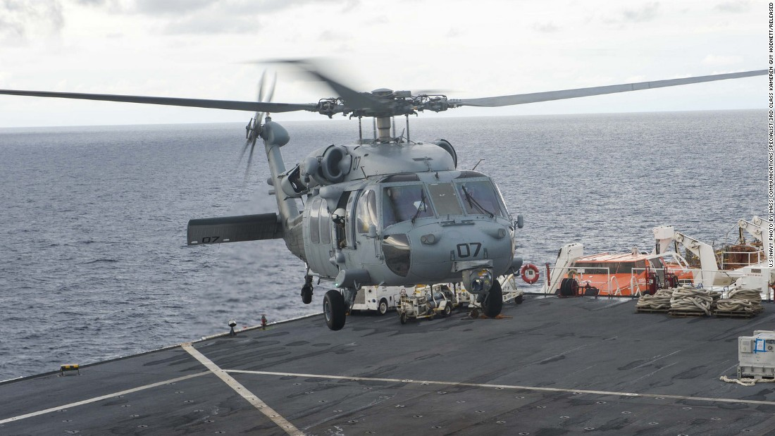 The floating hospital is equipped with an MH-60S Sea Hawk helicopter, pictured taking off from the flight deck.
