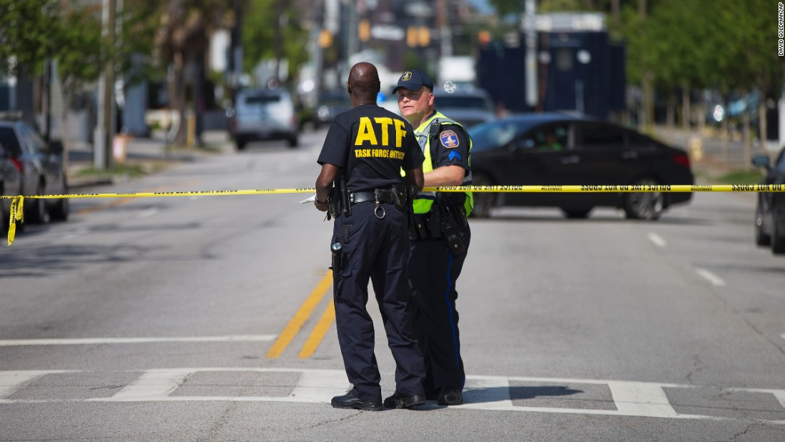Law enforcement officers in Charleston, South Carolina, stand guard near the scene of the shooting at Emanuel African Methodist Episcopal Church.