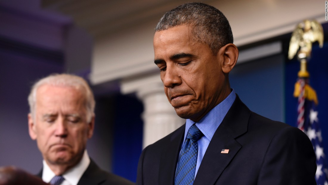 President Barack Obama, accompanied by Vice President Joe Biden, pauses while speaking in the Brady Press Briefing Room of the White House in Washington, June 18, on the church shooting in Charleston.