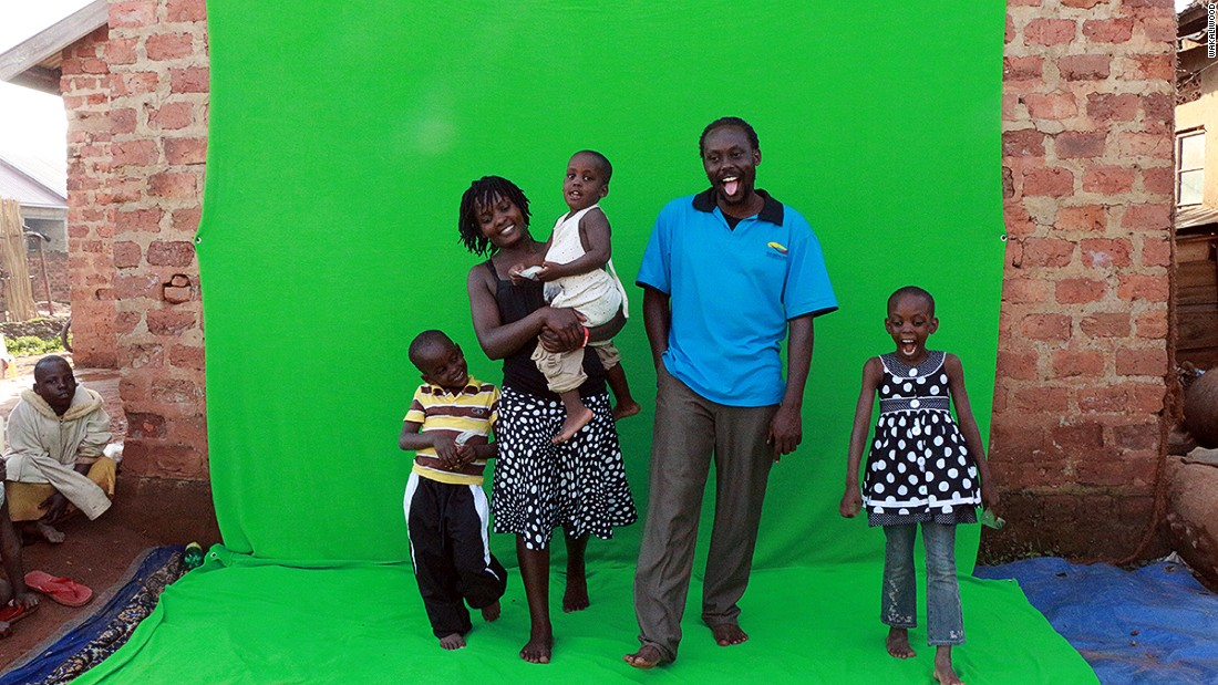 Nabwaana with his wife, Harriet and their three children, stand in front of the makeshift green screen. 'Uganda's motto is: For God and country, and we try and do everything at Wakaliwood for God and country,' says the filmmaker.