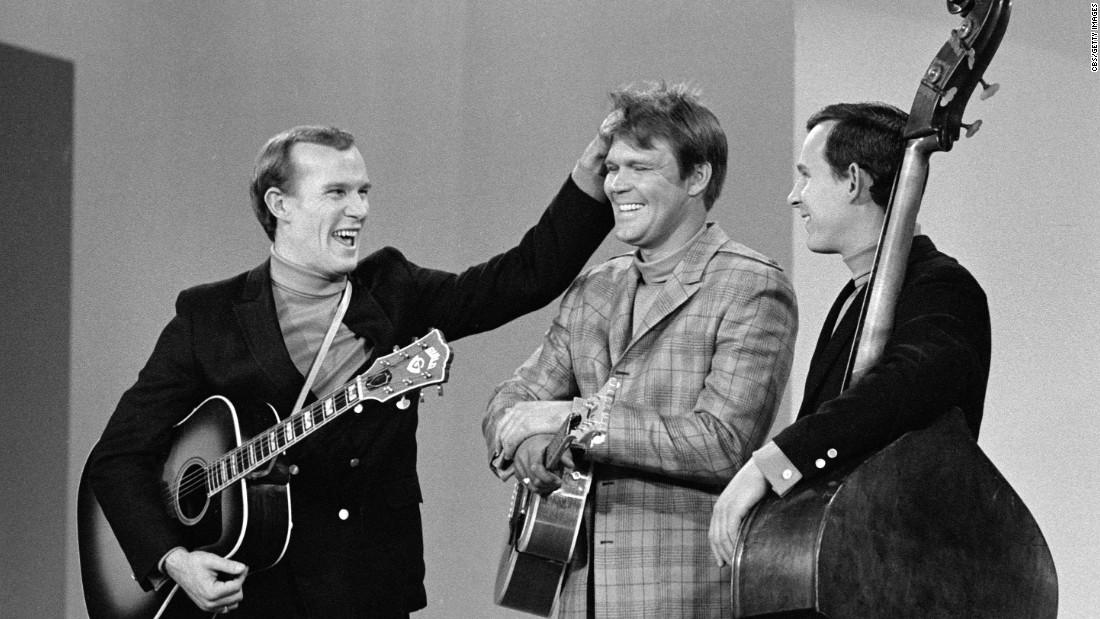 "Campbell became a regular on ""The Smothers Brothers Comedy Hour"" with Tom, left, and Dick Smothers. In 1968, Campbell became a co-host of the summer replacement series, ""The Summer Brothers Smothers Show,"" on CBS."