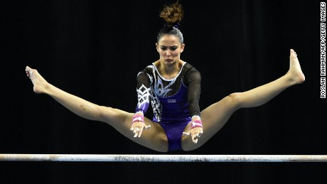 Malaysia's Farah Ann Abdul Hadi competes on the uneven bars during the women's individual all-around gymnastics final at the 28th Southeast Asian Games (SEA Games) in Singapore on June 8, 2015. AFP PHOTO / ROSLAN RAHMAN (Photo credit should read ROSLAN RAHMAN/AFP/Getty Images)
