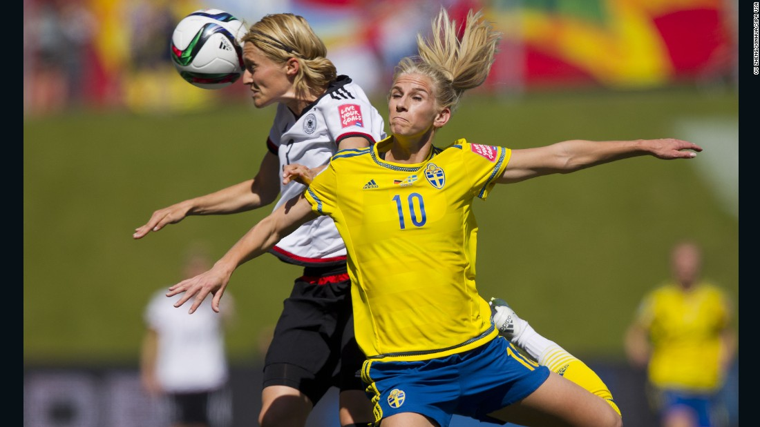 Germany's Saskia Bartusiak, left, collides with Sweden's Sofia Jakobsson during a round-of-16 match in Ottawa on June 20. Germany won 4-1 to advance to the quarterfinals.