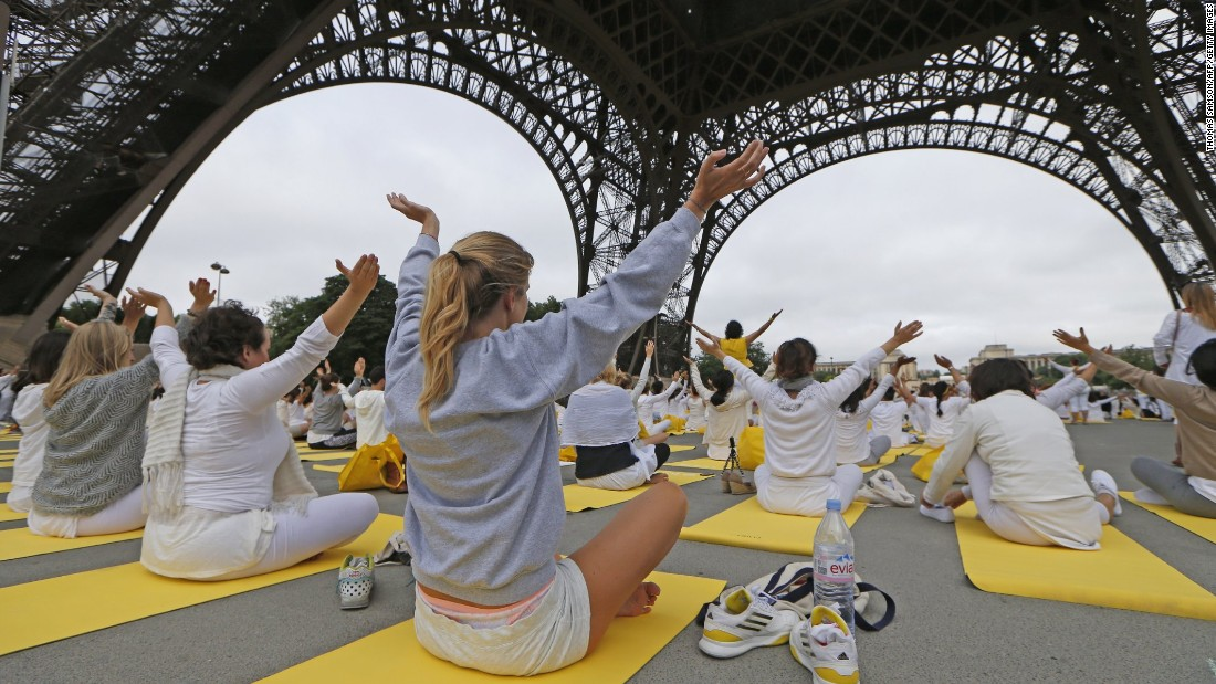Hundreds gather under the Eiffel Tower in Paris in June 2015, in a mass yoga session to mark the first International Yoga Day (192 countries joined the event).