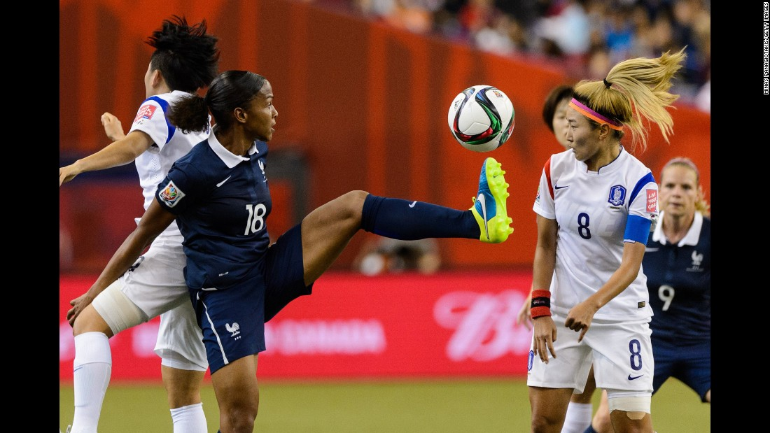 Marie Laure Delie of France kicks the ball in front of Cho So-hyun of South Korea during a round-of-16 match June 21 in Montreal. France won 3-0.