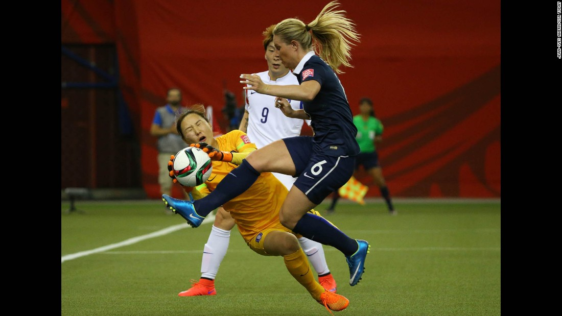 South Korean goalkeeper Kim Jung-mi makes a save against France's Amandine Henry during the first half.