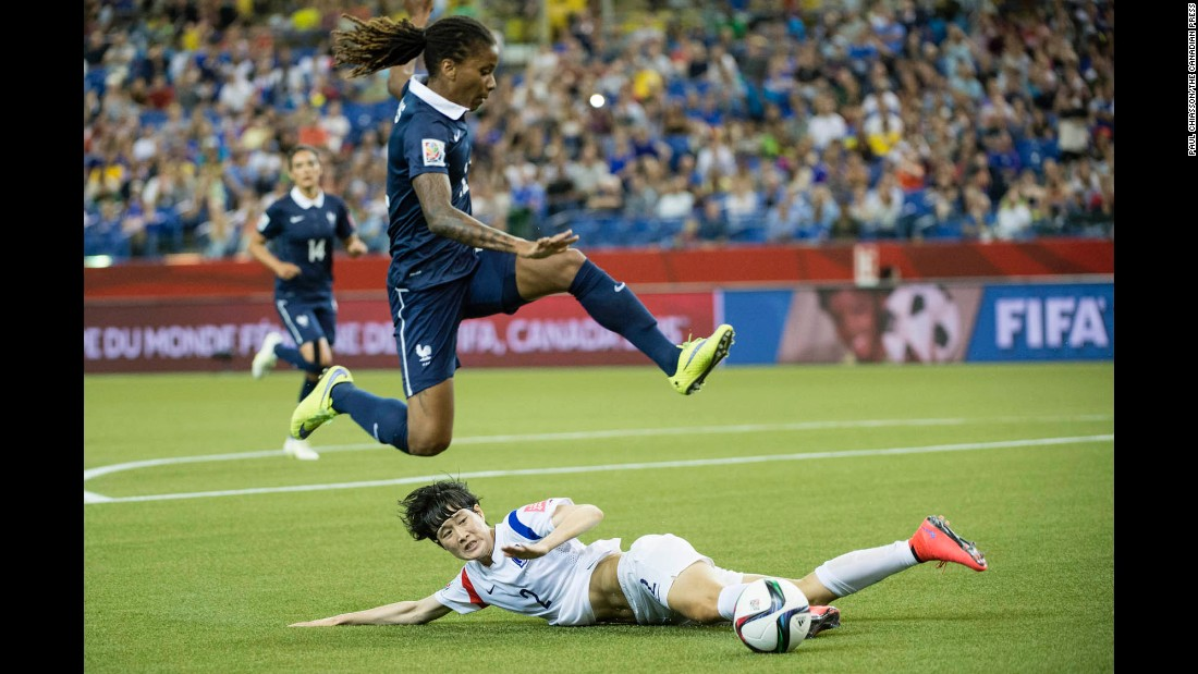 French midfielder Elodie Thomis leaps over South Korea defender Lee Eun-mi.