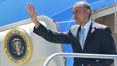 US President Barack Obama steps of Air Force One upon arrival at San Francisco International Airport on June 19, 2015. Obama is in San Francisco to address the US Conference of Mayors and to attend fundraisers.