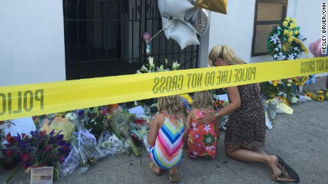 "SOUTH CAROLINA: ""Family paying their respects at the Emanuel AME Church, site of the Charleston shooting."" - CNN's Wesley Bruer, June 18. The man suspected of killing nine people Wednesday night at a historic African-American church in Charleston, was arrested Thursday morning about 245 miles (395 kilometers) away in Shelby, North Carolina. Dylann Roof, 21, of Lexington, South Carolina, was taken into custody without incident. Follow @wesbruer and other CNNers on the @cnnscenes gallery on Instagram for more images you don't always see on news reports from our teams around the world."