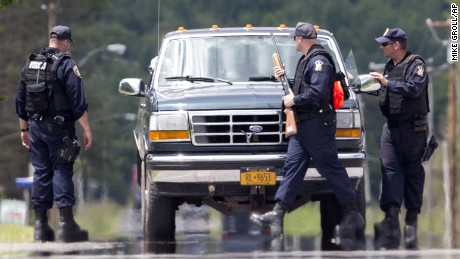 Corrections officers stop a vehicle on Monday, June 22, as the search continues for the two prisoners who escaped from the Clinton Correctional Facility in Dannemora, New York.