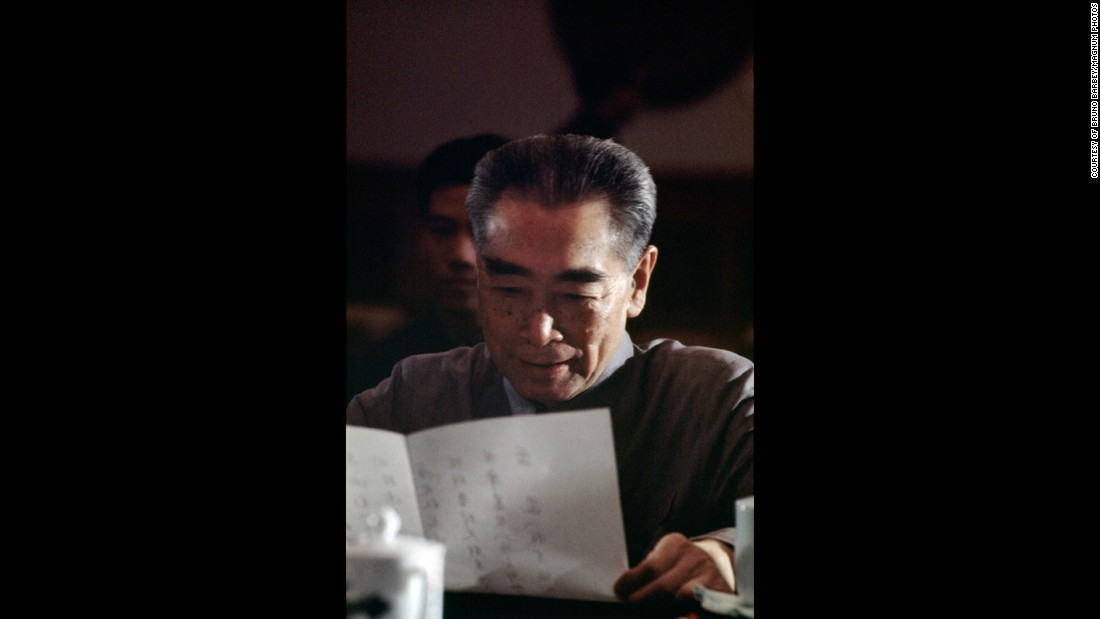 "Barbey also captured this unguarded moment of Zhou. ""He's not reading a speech, he's looking at the menu, and you can see on his face he's quite happy about what he's about to have for dinner."""
