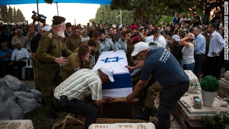 The casket carrying the body of Israeli soldier Jordan Bensimon is carried to the burial site during his funeral on July 22, 2014 in Ashkelon, Israel.