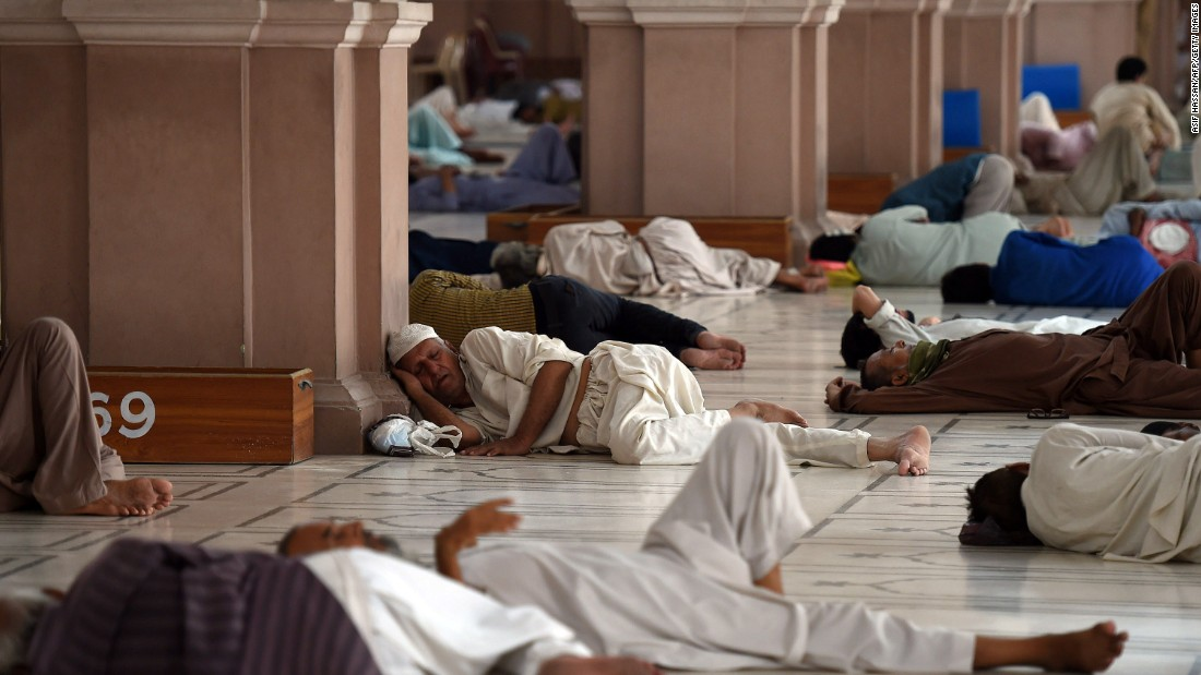 Pakistanis rest at the mosque during the heat wave in Karachi on June 22.