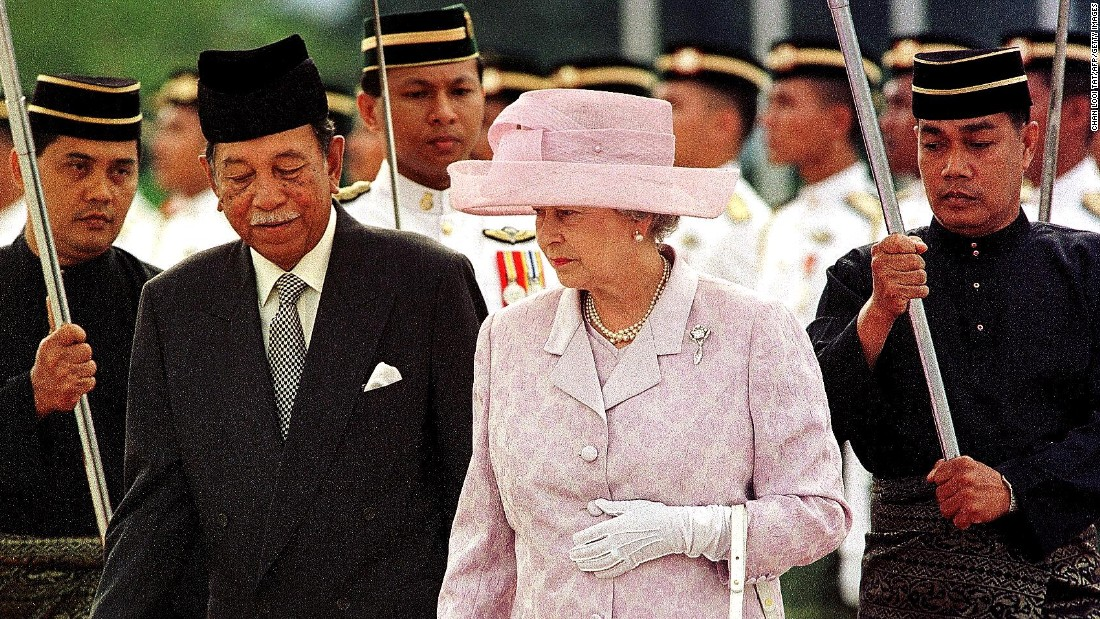 Queen Elizabeth II is escorted by Malaysia's King Jaafar during the official welcoming ceremony in Kuala Lumpur in September 1998. She visited Malaysia on that occasion to officiate the closure of the XVI Commonwealth Games.