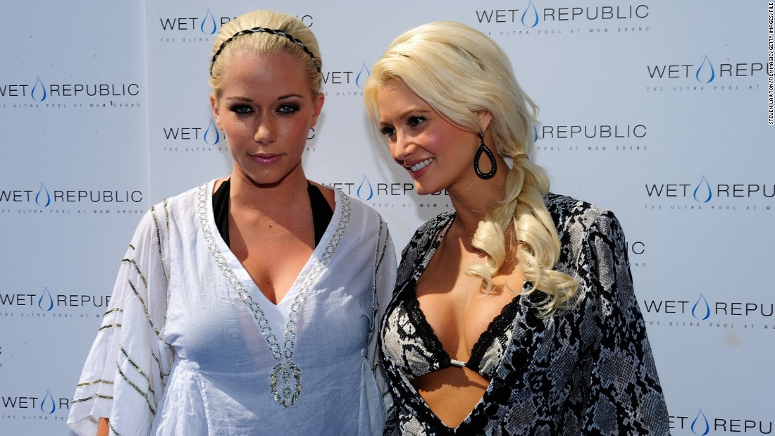 Playboy founder Hugh Hefner's former girlfriends Kendra Wilkinson-Baskett, left, and Holly Madison argued over Madison's portrayal of their former life at the Playboy Mansion in her new book.