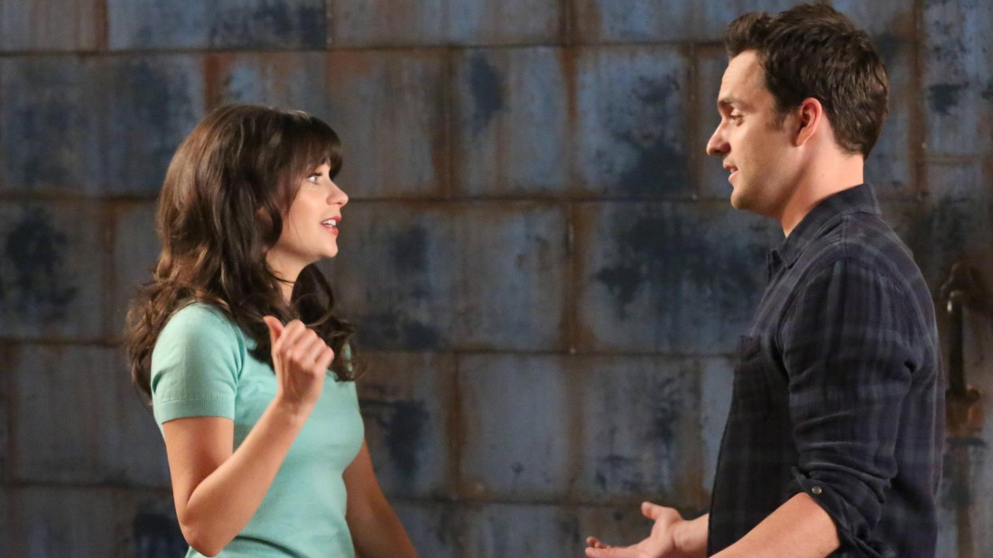 Zooey Deschanel as 'Jess' and Jake Johnson as 'Nick' i