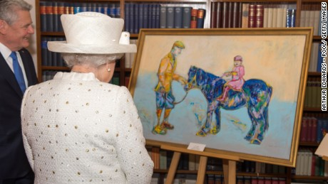 BERLIN, GERMANY - JUNE 24: President of Germany Joachim Gauck presents Queen Elizabeth II with a painting of her and Farther when she was a little girl at the Schloss Bellevue Palace on the second day of a four day State Visit on June 24, 2015 in Berlin, Germany. (Photo by Arthur Edwards - Pool/ Getty Images)