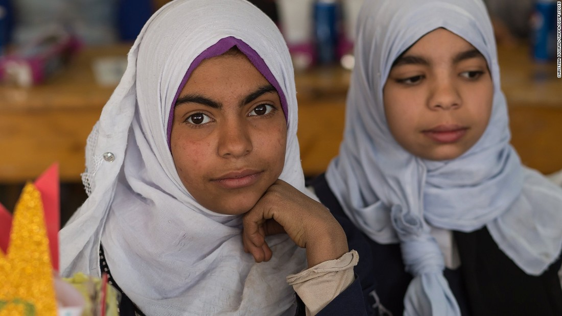 "Most Egyptian girls are ""cut,"" as it is often called, between the ages of nine and 12. Here, in a photo provided to CNN by the UNFPA, children of a similar age attend class at a school in Assiut on February 1."