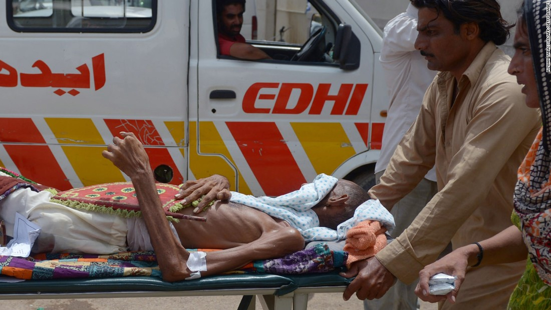 Pakistanis bring a heatstroke victim to a hospital in Karachi on Thursday, June 25. More than 1,000 people have died in a heat wave in southern Pakistan, officials say.
