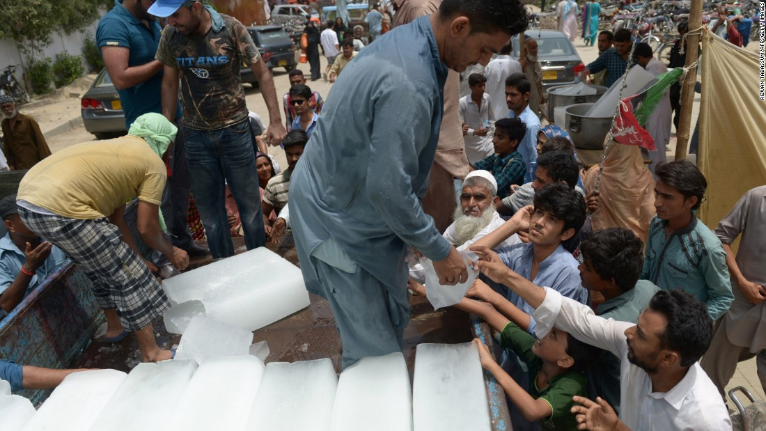 Pakistanis receive ice during the heat wave in Karachi on June 24.
