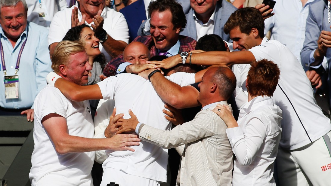 Novak Djokovic (middle) celebrates his Wimbledon 2014 championship surrounded by his  friends, family and staff. Top players will often splurge on added housing for their friends and family on the road. Meanwhile, not all players in the top 100 can afford to travel with a coach full-time.