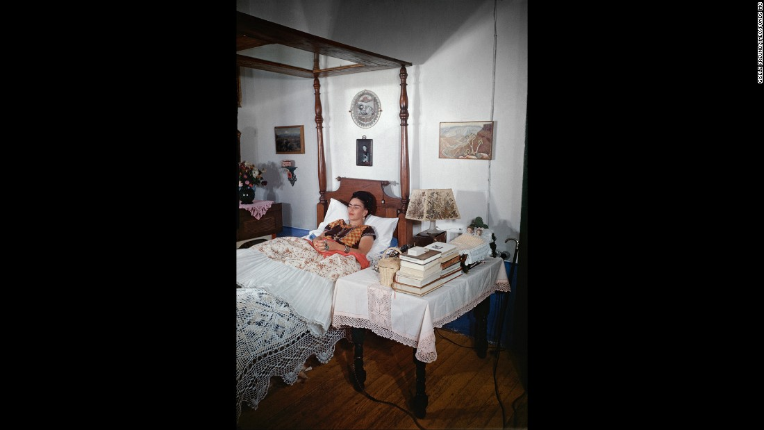 As a teenager, Kahlo was critically injured in a bus accident and confined to a bed. She suffered from ill health for the rest of her life. Here, she is shown in her bedroom in 1951.
