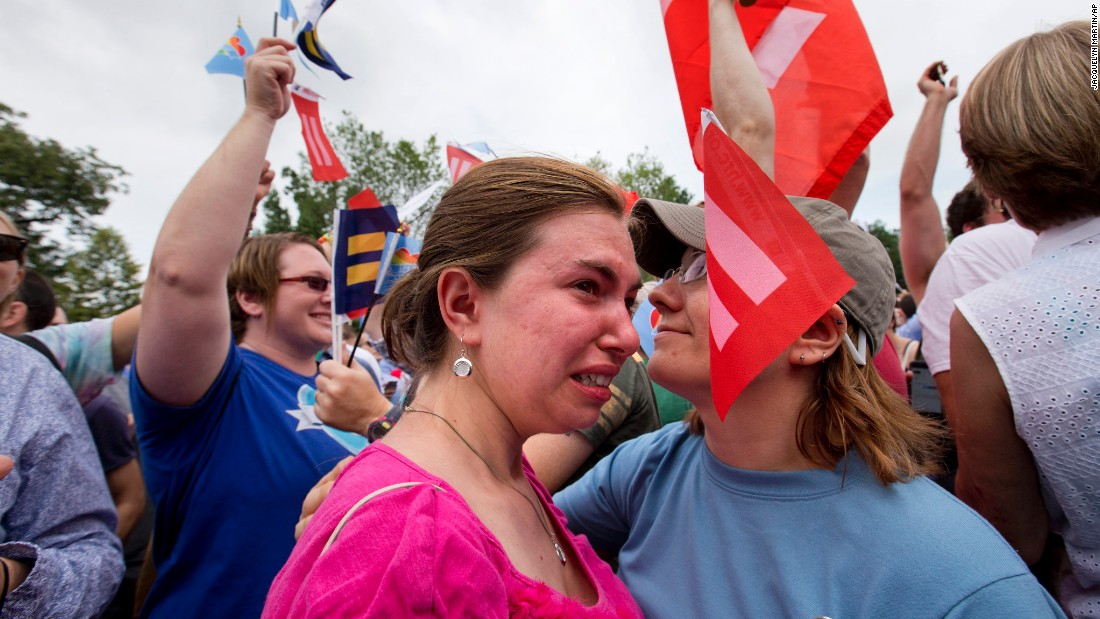 Ariel Olah, left, and her fiancee, Katie Boatman, are overcome by emotion outside the U.S. Supreme Court in Washington on Friday, June 26.