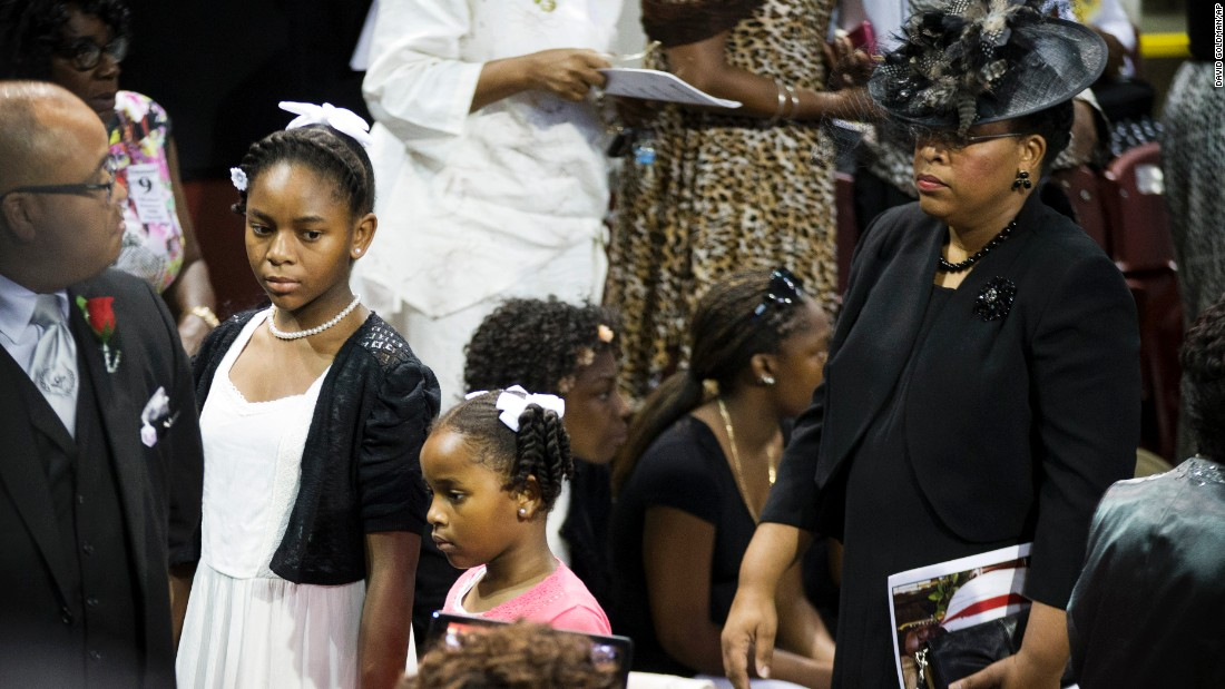 Pinckney's wife, Jennifer, attends the service with her daughters Eliana, left, and Malana.