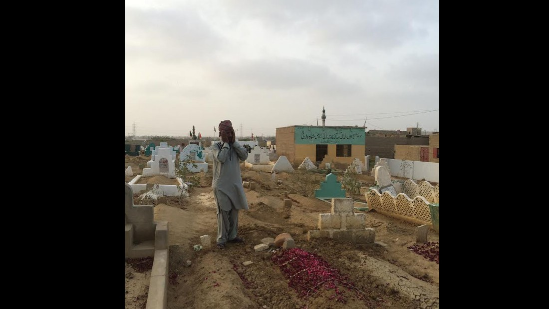 Sameer prays at the graves of his children. Ten people died because of heat related ailments in this neighbourhood alone.