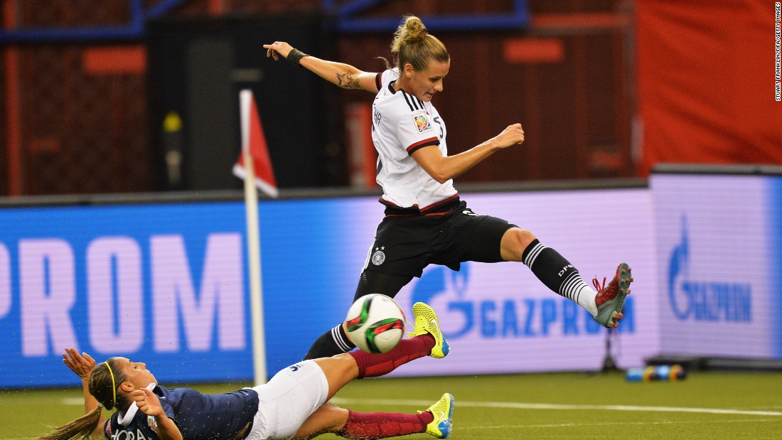 Germany's Simone Laudehr, right, is challenged by Jessica Houara of France during a quarterfinal match in Montreal on June 26. Germany advanced after winning a penalty shootout.