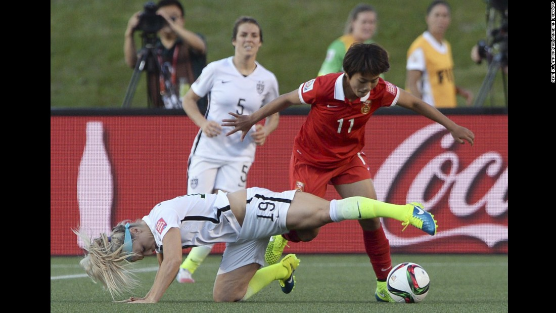 Johnston and China's Wang Shuang vie for the ball during the second half.